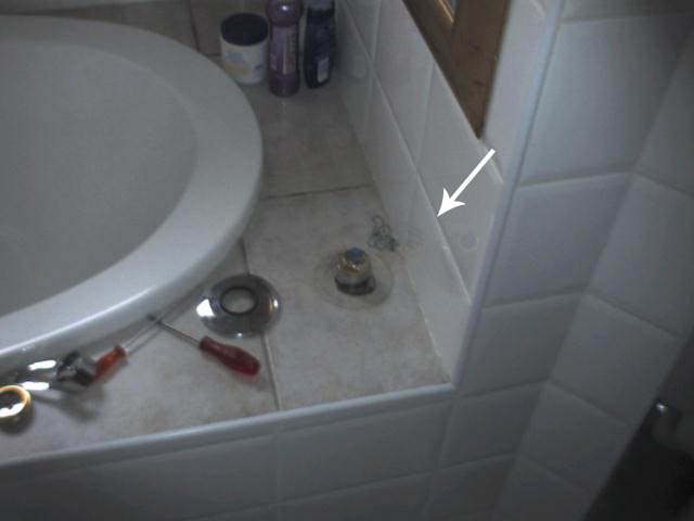 water leak under bath rim